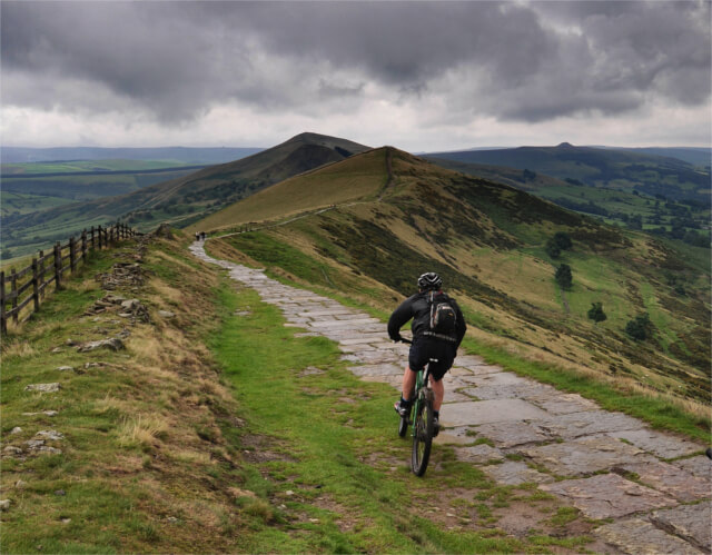 Lone cyclist on Mam Tor