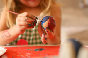 Toddler painting Easter Egg