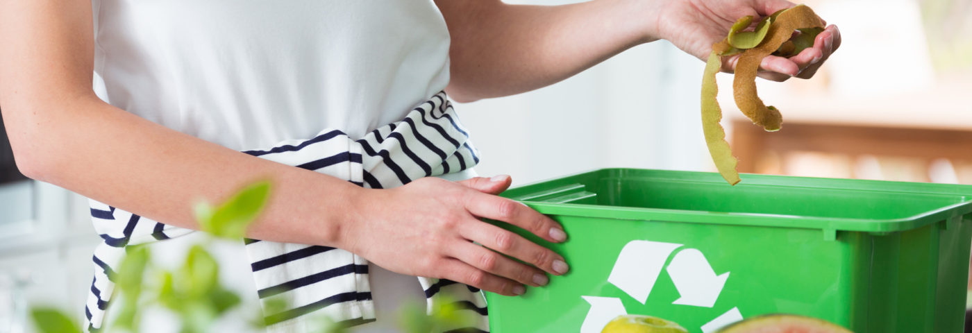 Woman recycling food waste