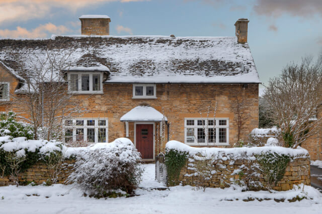 Cotswolds house covered in snow