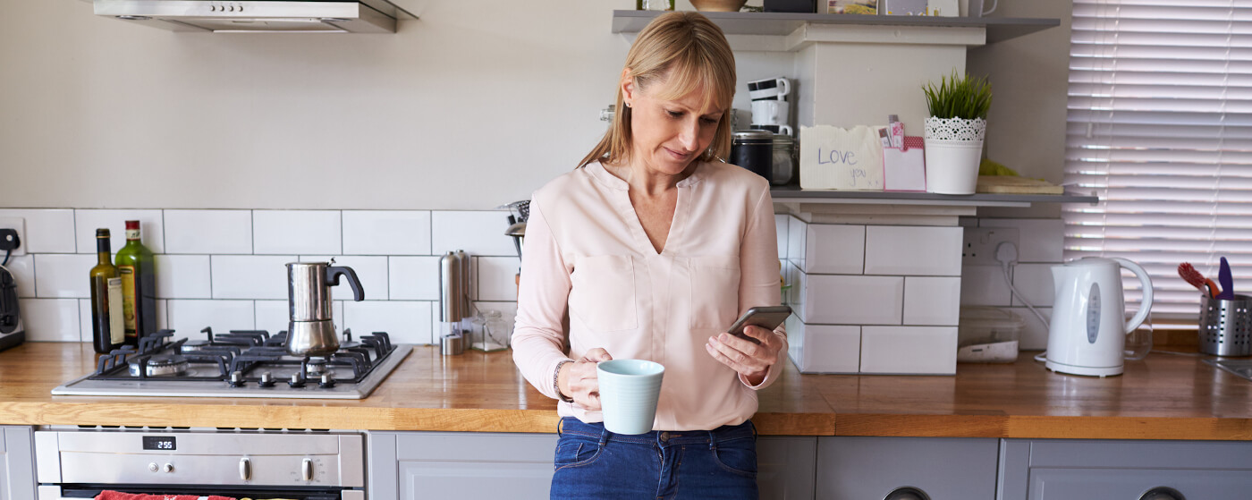 Cottage owner checking reviews on social media