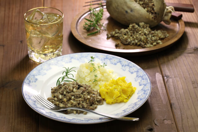 haggis neeps and tatties on a white plate