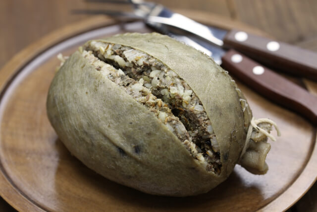 haggis on plate with cutlery