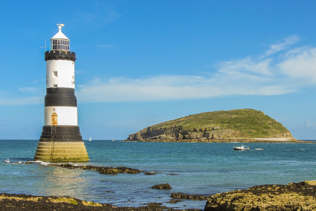 Trywyn Du Lighthouse in North Wales with Puffin Island in the background