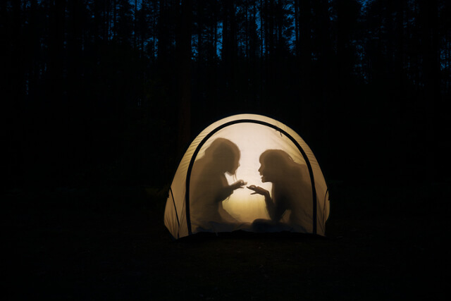playing in a tent at night time
