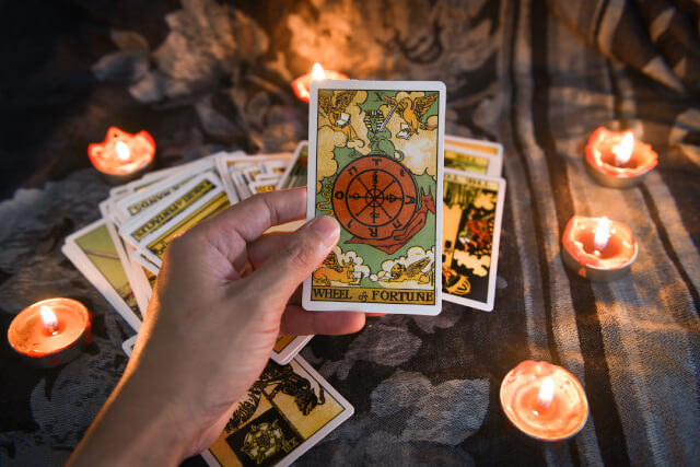 tarot card with candlelight