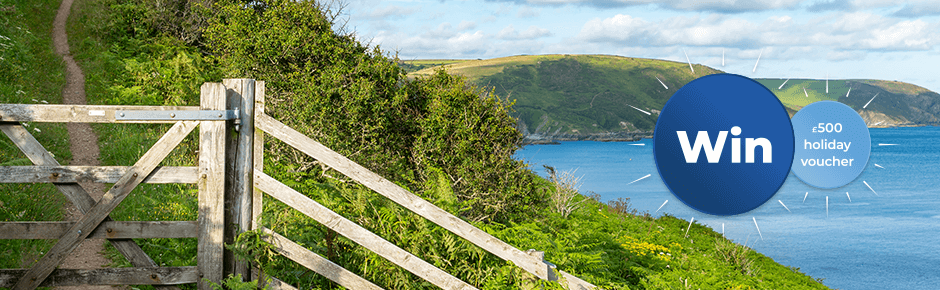 Close up of wooden gate on a coastal path with seascapes in the background
