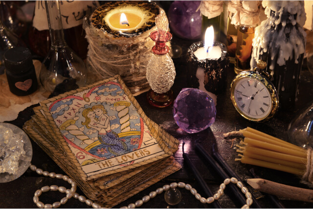 tarot cards with crystal, candles and magic objects