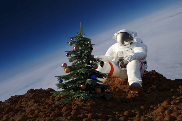 astronaut in space with christmas tree