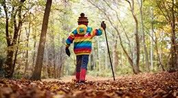 Boy walking in the woods, enjoying the countryside