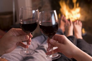 Snuggle up in front of a log fire at a holiday cottage from Sykes Cottages