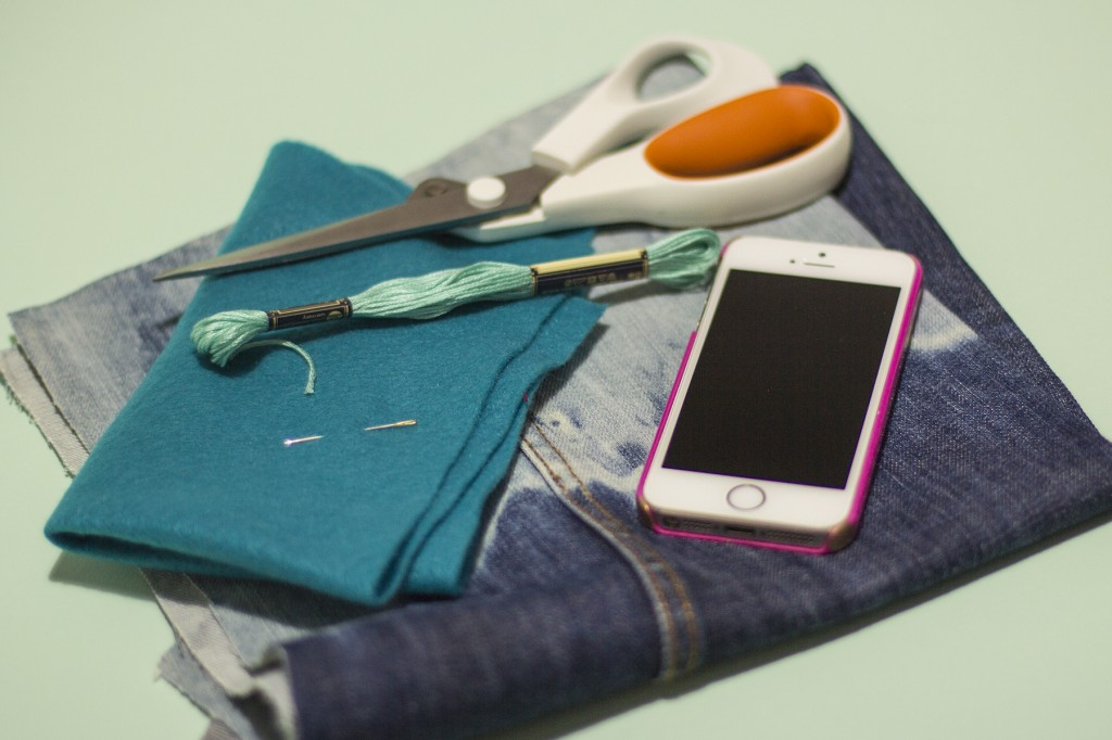 Materials to create an upcycled denim phone pouch