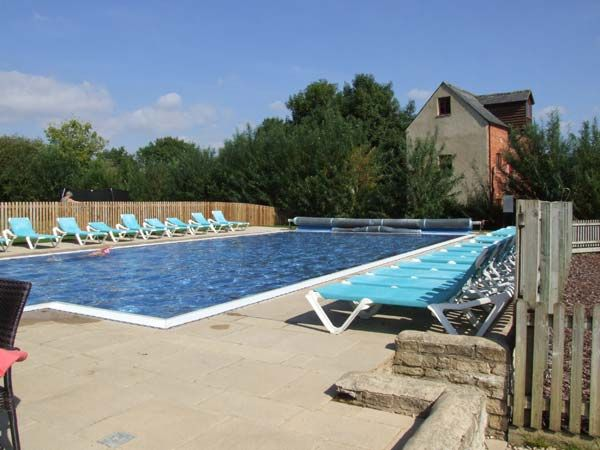 Swimming pool available at Bridge House (Reference 915721) in Lower Mill Cotswolds Estate.