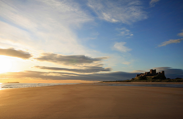 Bamburgh Castle and Beach by  David Dawson / CC BY 2.0