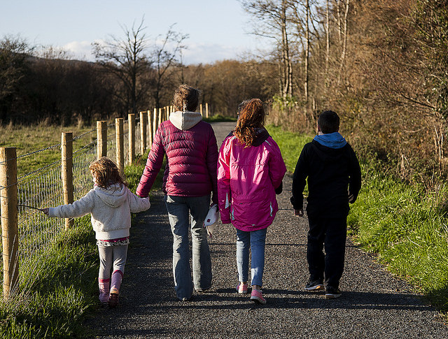 A family of four walking in the country