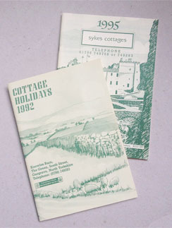 Photo of brochures from 1992 and 1995